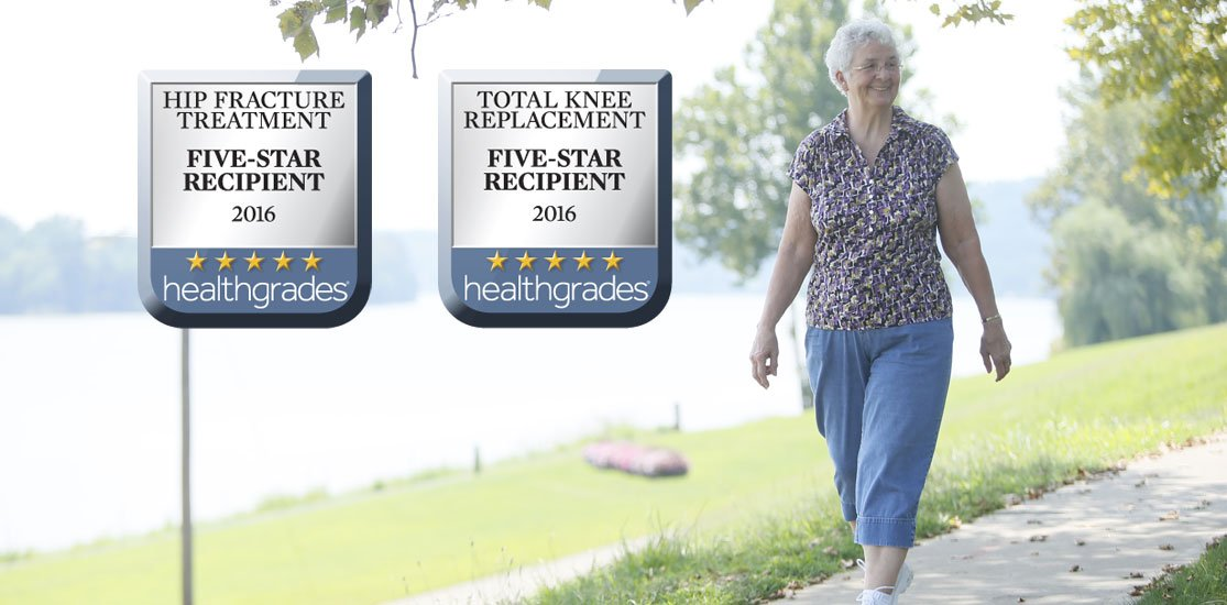 Woman walking in the Gallipolis City Park; Healthgrade awards