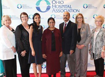 Renuka Kandula, MD (center) with family and fellow staff members