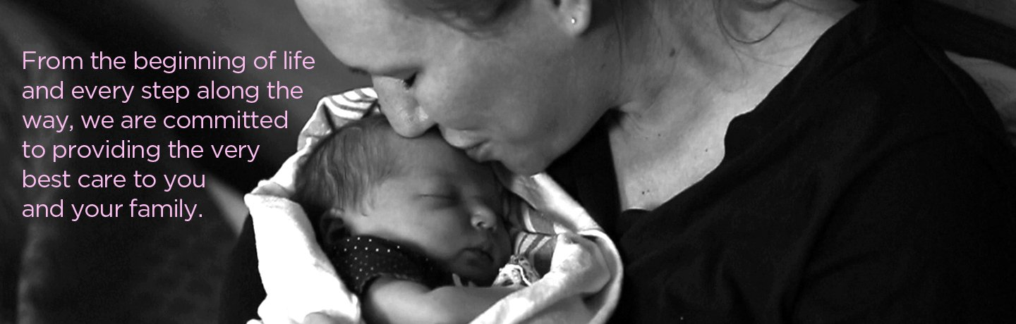 Banner Image - Mom kissing baby on forehead.